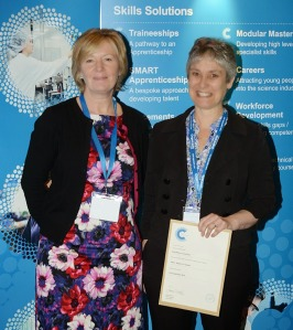 Elisabeth Goodman receiving the Cogent Skills Assured Training Provider certificate on behalf of RiverRhee Consulting