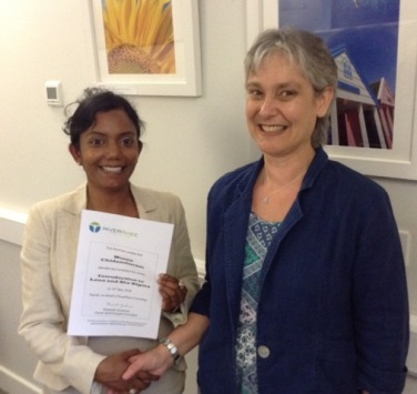 Meena Chidambaram receiving her certificate after completing one of our courses